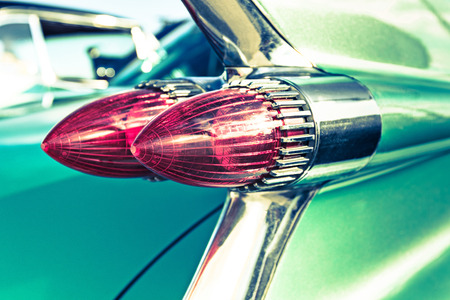 Closeup of a rear light of an old Cadillac.