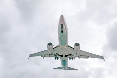 underbelly: Jet airplane preparing for landing.