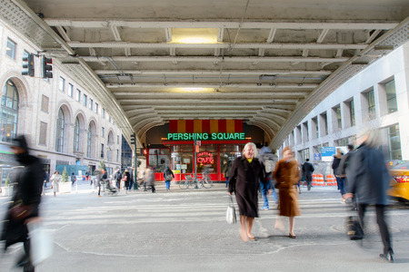pershing: New York, February 21, 2017: People are crossing the 42nd street directly across the main entrance to Grand Central, long exposure, blurred view. Editorial