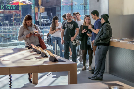 manhattans: New York, October 5, 2016: People stand in line in the Apple store on Manhattans Upper West Side waiting to purchase a new iPhone.