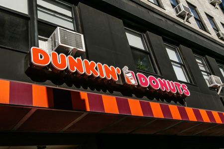 New York, February 6, 2017: Dunkin Donuts sign above one of their numerous locations in Manhattan.