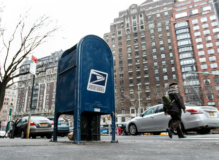 New York, January 21, 2017: A United States Postal Service box stands on the sidewalk on Amsterdam Avenue in Manhatan.