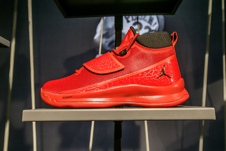 New York, February 21, 2017: A red Air Jordan basketball sneaker for sale in the NBA store in Manhattan. Editorial
