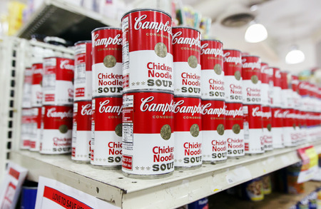 Saint Martin, Dutch Antilles, March 18, 2017: Cans of Campbell's chicken noodle soup stand on a shelf in a supermarket. Editorial