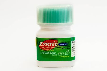 New York, May 26, 2017: Bottle of Zyrtec capsules stands against white background. Zyrtec is an allergy relief medicine.