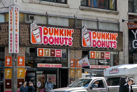 New York, May 08, 2017: Exterior signs on one of Dunkin Donuts locations in Manhattan.