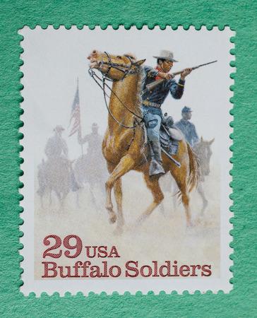US Christmas postzegel met een illustratie van Buffalo Soldiers. Redactioneel