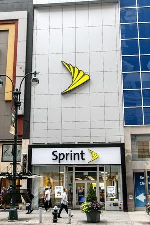 New York, July 27, 2017: People walk by a Sprint store in Manhattan. Редакционное