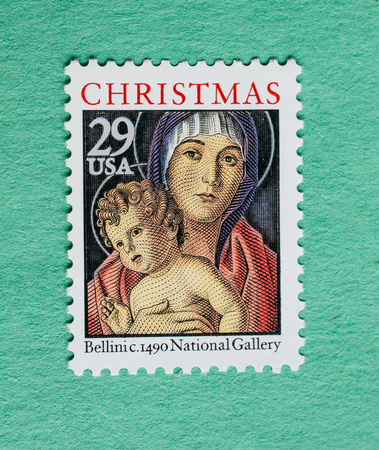 US Christmas postage stamp with an illustration from a painting by Bellini. Editorial