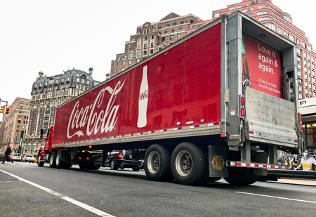 New York, February 28, 2017: A Coca-Cola. truck has stopped on the red light on Amsterdam Avenue. 新闻类图片
