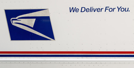 New York, April 28, 2017: Closeup of a side of a USPS truck with the services logo and motto.