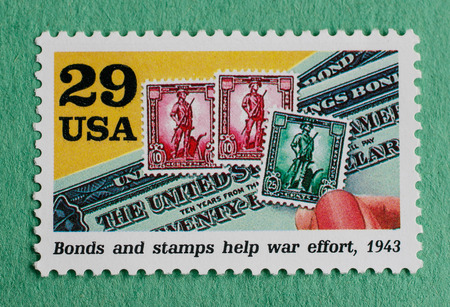 US Christmas postage stamp with an illustration of bonds and stamps issued during WW2 to help the war effort. Editorial