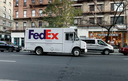 New York, November 28, 2016: A FedEx van is double parked on Columbus Ave. Stock Photo - 83708854