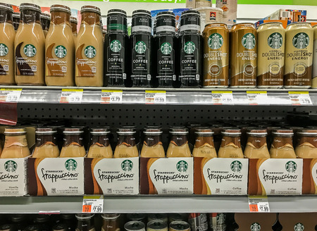 Basking Ridge, NJ, August 6, 2017: Variety of Starbucks products on a shelf of a supermarket.