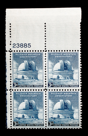Set of four US postage stamps.