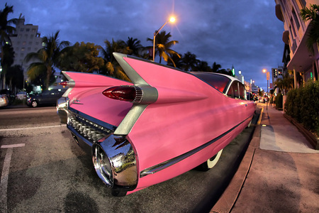 Classic pink Cadillac on streets of Miami Beach Editorial