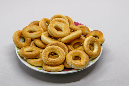 Russian bread rings, called baranki, on a small plate.