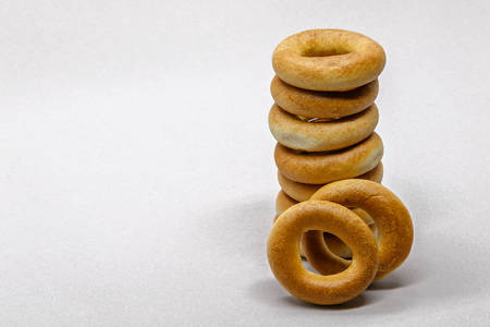 Stack of Russian bread rings isolated on light background. Stock Photo