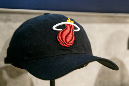 New York, October 20, 2017: Miami Heat hat on sale in the NBA store in Manhattan. Editorial