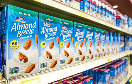 Holetown, Barbados, 03-19-2018: Cartons of Blue Diamond Almond Breeze stand on a shelf of a local supermarket.