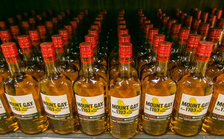 Holetown, Barbados, 03-19-2018: Bottles of Mount Gay Eclipse rum stand on a shelf of a local supermarket.