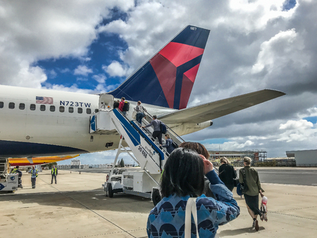 Lisbon, Portugal, May 12, 2018: Delta Airlines passengers are boarding a plane for their international flight.