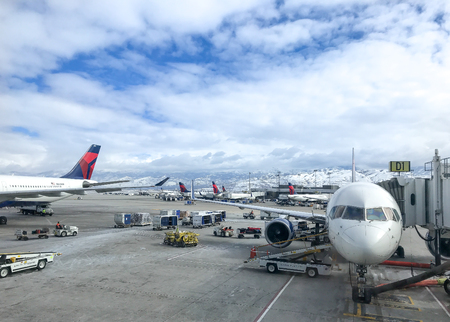 Salt Lake City, March 5, 2018: Delta jet planes on the airport tarmac waiting to be boarded by passengers.