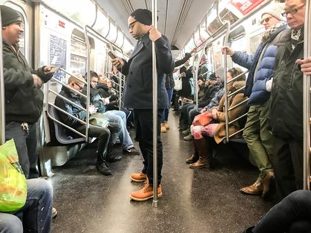 New York, Februrary 17, 2017: Passengers are riding NYC subway.