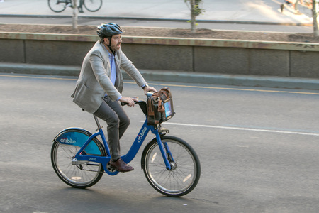 New York, September 12, 2016: A man is riding a bicycle along Park Avenue in Manhattan.