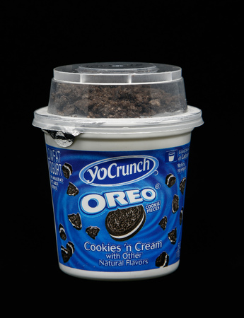 New York, December 4, 2017:  Container of Oreo Cookies and Cream yogurt stands against black background. Imagens - 121806208