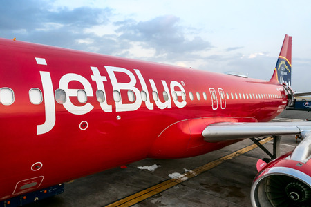 Barbados, March 28, 2018: jetBlue aircraft, painted red in honor of FDNY, bound for JFK airport is ready for the passengers to board. 에디토리얼
