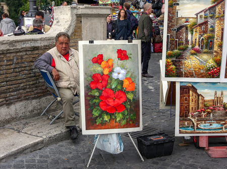 Rome, October 23, 2010: Man is selling paintings by the Spanish Steps. 에디토리얼