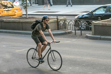 New York, September 12, 2016: Man is riding a bicycle along Park Avenue in Manhattan.