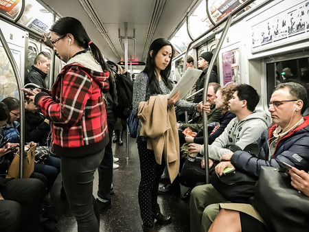 New York, March 1, 2017: People ride in NY subway.