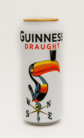New York, August 8, 2017: A limited edition Guiness beer can stands against white background. 에디토리얼