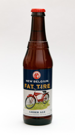 New York, January 5, 2017: A bottle of Fat Tire amber ale is seen against white background. 에디토리얼