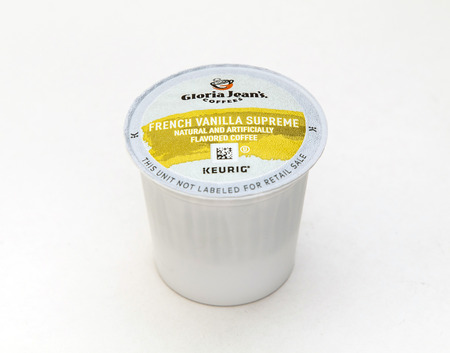 New York, January 5, 2017: A single french vanilla flavored coffee capsule for Keurig coffee machine by Gloria Jeans is seen against white background.