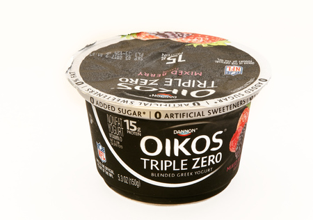 New York, August 8, 2017: A package of Oikos Triple Zero yogurt stands against white background.