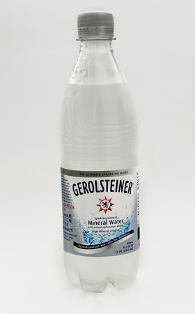 New York, August 8, 2017: A bottle of Gerolsteiner mineral water stands against white background. 에디토리얼