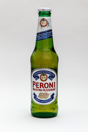 New York, January 5, 2017: A bottle of Peroni beer is seen against white background. 에디토리얼