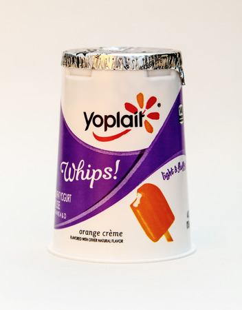 New York, January 5, 2017: An orange creme flavored Yoplait whipped yogurt is seen against white background. 에디토리얼