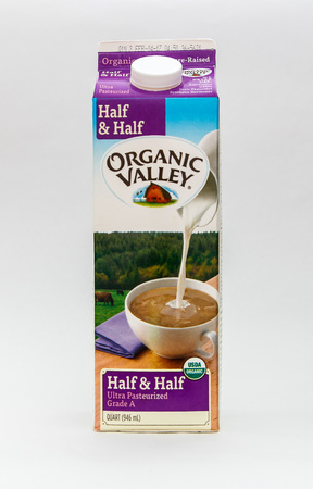 New York, January 5, 2017: A carton of Half & Half dairy beverage by Organic Valley is seen against white background. 에디토리얼