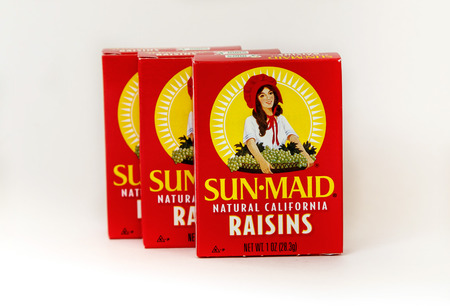 New York, December 02: Three small boxes of Sun Maid raisins isolated on white.