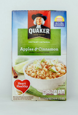 New York, September 17, 2017: Pack of Quaker instant oatmeals stands against white background. 에디토리얼