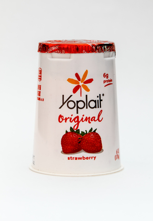 New York, January 5, 2017: A strawberry flavored Yoplait yogurt is seen against white background.