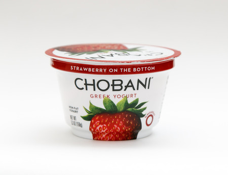 New York, January 23, 2017: A container of strawberry Chobani greek yogurt stands against white background.