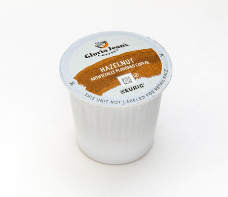 New York, January 5, 2017: A single hazelnut flavored coffee capsule for Keurig coffee machine by Gloria Jeans is seen against white background.
