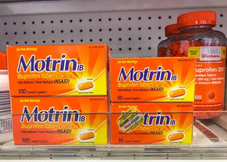 New York, 2272019: Packs of Motrin and Ibuprofen stand on a shelf at a Walgreens pharmacy.