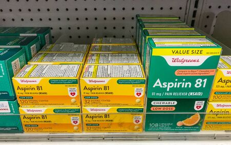 New York, 2/27/2019: Packs of Aspirin stand on a shelf at a Walgreens pharmacy.