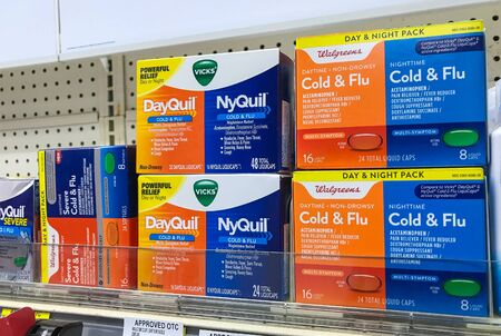New York, 2142019: Packs of DayQuil and NyQuil stand on a shelf in a drug store. Editorial